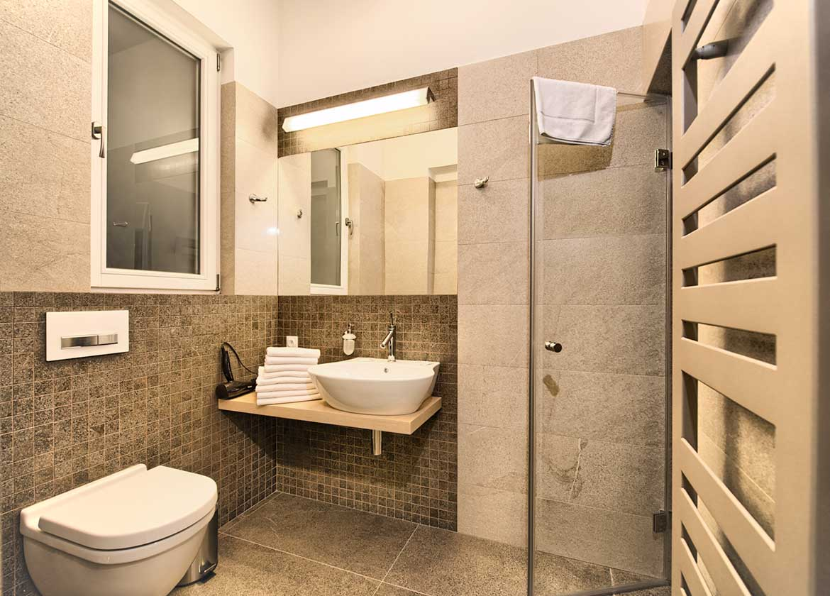 Beautiful bathroom with a steam shower in the Krizovnicka Apartments